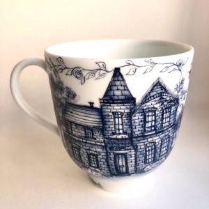 Coastal home in Wales mug, side view